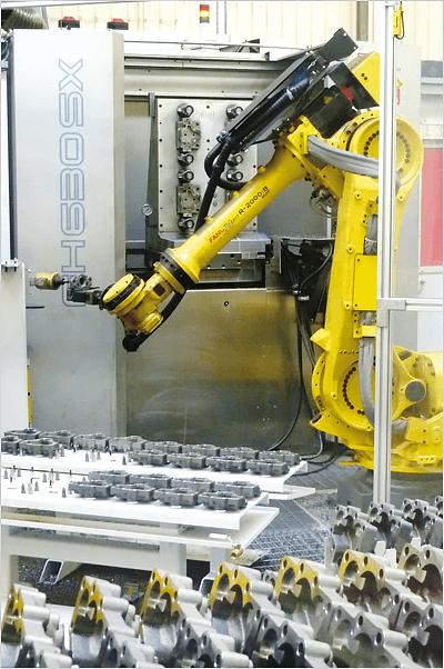 Aumentare la produttività con l'automazione della fabbrica - cella di sbavatura