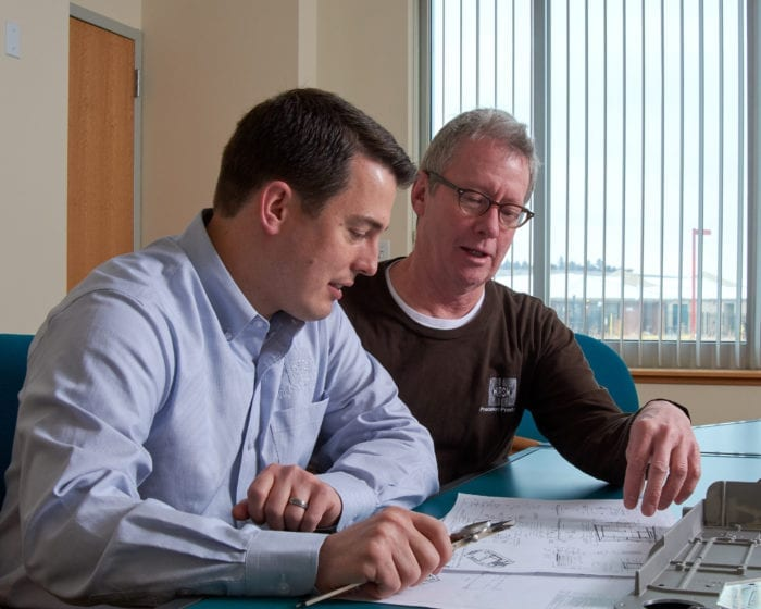 Hirsh Precision Products Chief Operating Officer Peter Doyle and Director of Engineering Steve Hirsh discuss a new customer's application.