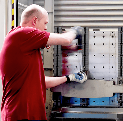 Safe and ergonomic loading and unloading of parts from flexbile manufacturing system