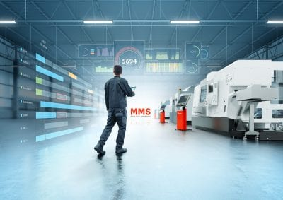 Operator on shop floor with stand alone machine tools
